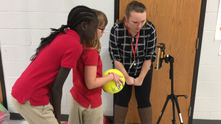Haley working with students.